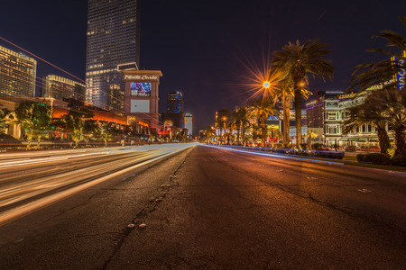 taillight: Streaks of light from a passing cars along the strip