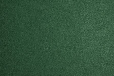 table surface: Green felt surface of a gambling table Stock Photo