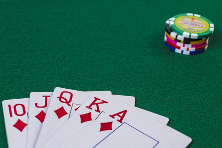 straight flush: Poker chips and straight flush cards on gambling table