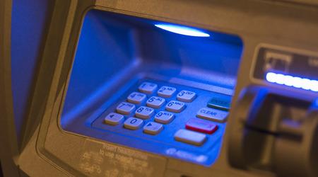 technology transaction: Blue light on ATM machiine key pad