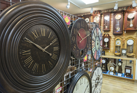 Different clock on display inside clock store Stock Photo