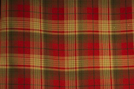 british culture: Red, yellow and black Scottish tartan fabric pattern