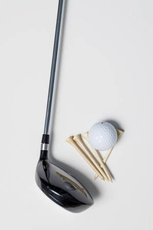 Essential gold equipment , ball tee and club. Stock Photo