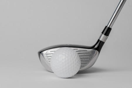 back ground: Golf club and ball on white back ground Stock Photo