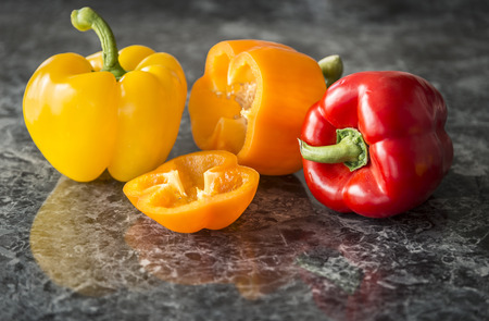 A variety of bell pepper on top of granite counter top