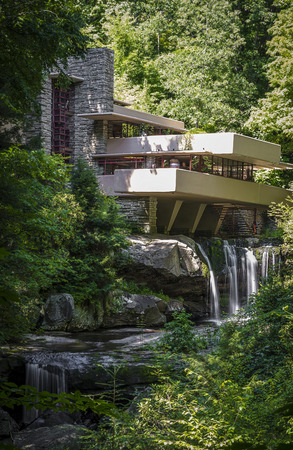 deflection: Fallingwater or Kaufmann Residence is a house designed by architect Frank Lloyd Wright in 1935 in rural southwestern Pennsylvania, 43 miles (69 km) southeast of Pittsburgh.[4] The home was built partly over a waterfall on Bear Run in the Mill Run section  Editorial