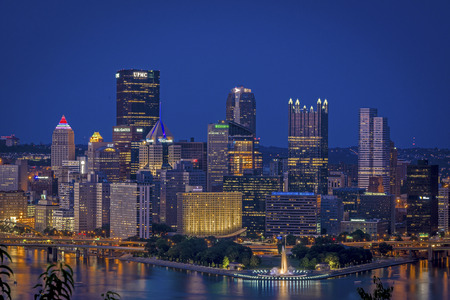 allegheny: Skyline of Pittsburgh during dusk with blue back ground