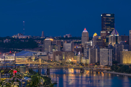 allegheny: Skyline of Pittsburgh along the three sisters bridge