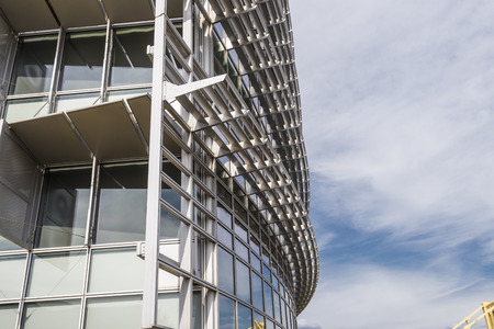 aluminum: Modern glass , aluminum and steel building with sky in the background