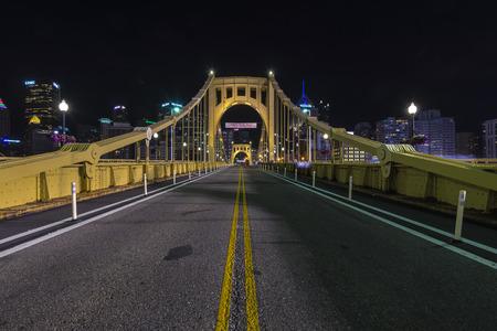 An empty Roberto Clemente bridge at  night