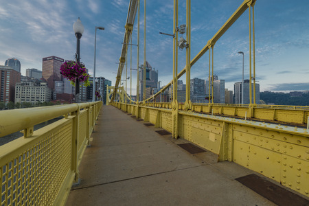 allegheny: Yellow painted Roberto clemente bridge in the morning
