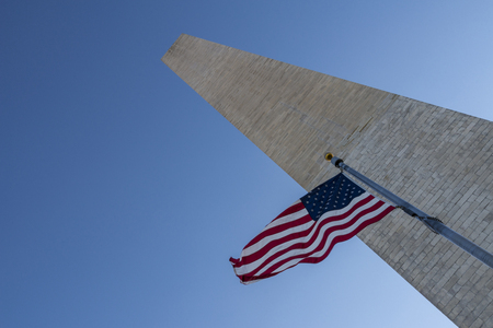 washington monument: Flag waving infront of washington monument