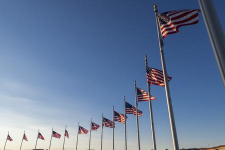 Waving flags surrounding washington monument