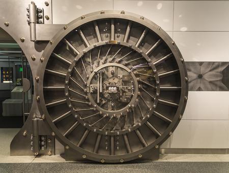 toughness: An open steel bank vault door, a symbol of toughness.