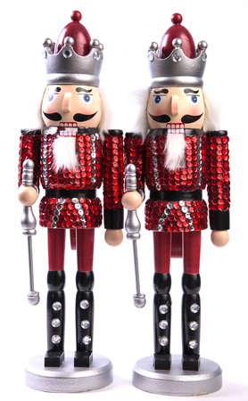 A nutcracker is a tool designed to open nuts by cracking their shells. They are made in many styles, with a particularly well-known type portraying a person whose mouth forms the jaws of the nutcracker. Archivio Fotografico