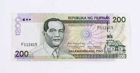 A 200 philippine peso bill on white back ground