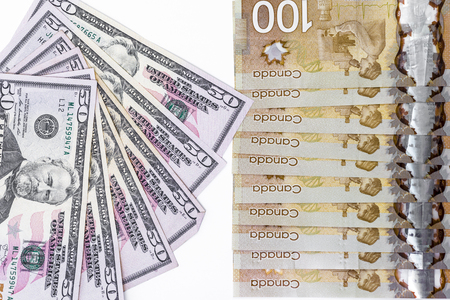 canadian dollar: US dollar and canadian dollar onwhite back ground Stock Photo