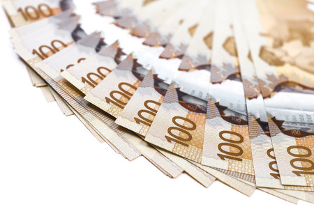 Close up shot of 100$ canadian bills Stock Photo
