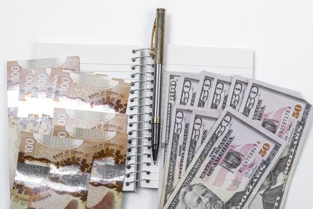 white back ground: Noebook, pen, cash on white back ground
