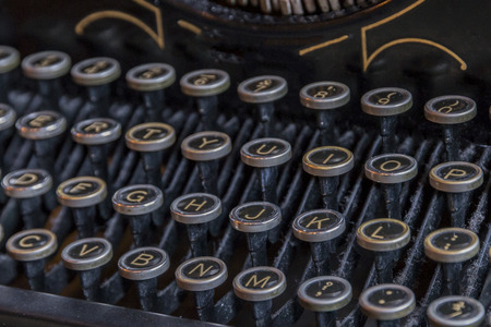 The keys of an antique and old type writer. Reklamní fotografie