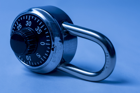 combination: Combination lock on its side with bluish tint Stock Photo
