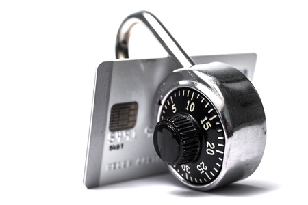secure site: Credit cards with combination lock on white back ground