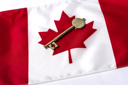 canadian flag: A key on top of a Canadian flag