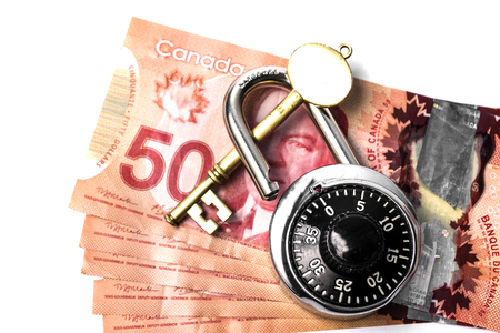 Canadian 50$ bills with combination lock and key on top