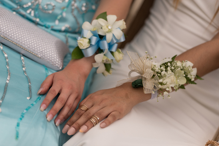 Prom Corsages strap on the hand of two female prom attendee.