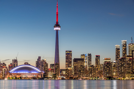 building cn tower: Toronto skyline with CN tower during dusk. Stock Photo