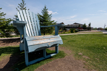 adirondack: An over size wooden adirondack chair at blue mountain. Stock Photo