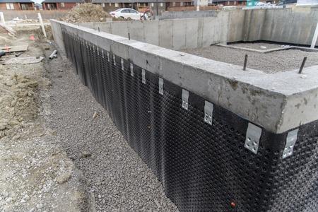 Basement wall waterproofing membrane installed