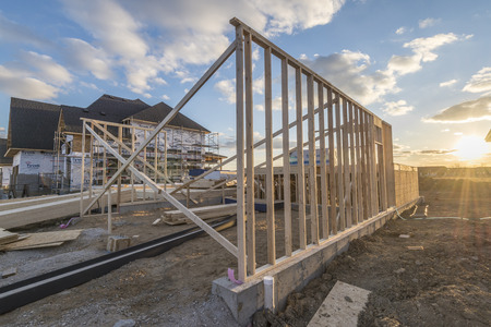 Construction site of a house being built. Reklamní fotografie - 75370634
