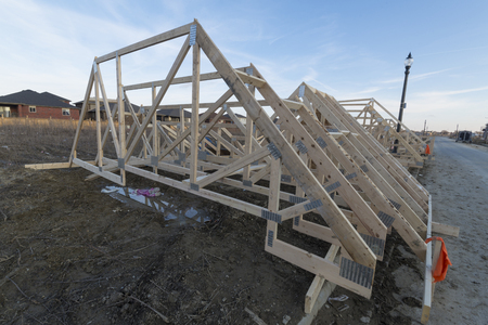 rafters: Assembled trusses ready to be lift on top of houses.