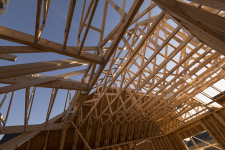 attic: New construction house trusses and wooden frames.