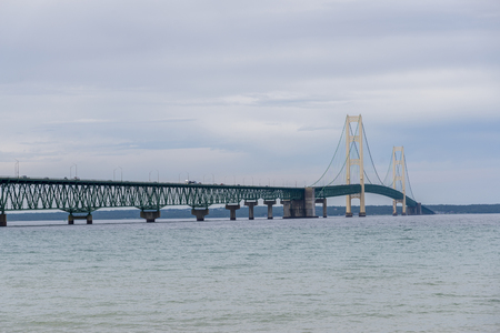 The Mackinac Bridge  is a suspension bridge spanning the Straits of Mackinac to connect the Upper and Lower Peninsulas of the U.S. state of Michigan.