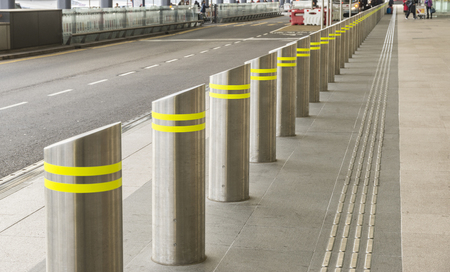 Series of bollards on the side street for safety