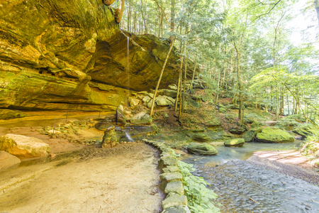 Old Mans Cave is part of the Hocking Hills State Park near Logan, Ohio. The cave is one of Ohios most popular natural history attractions.