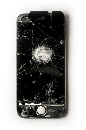 Badly beaten and damage smart phone on white background