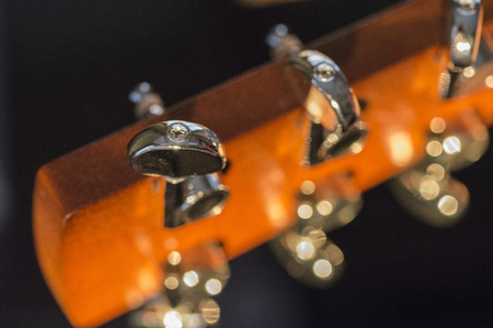 Macro shot of a golden color guitar head. Banco de Imagens