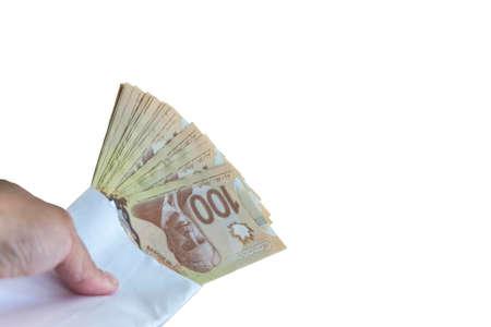 100 dollar canadian bills inside the envelop on white back ground.