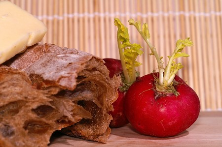 redish: Still-life with ciabatta, redish and cheese on wooden plate Stock Photo