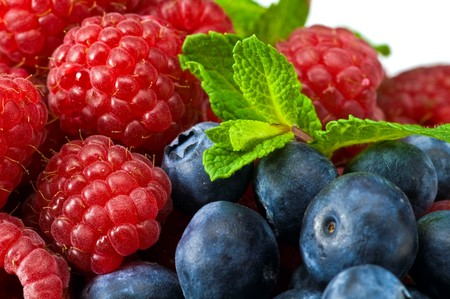 Fresh ripe raspberry and blueberry with green mint leaves  photo