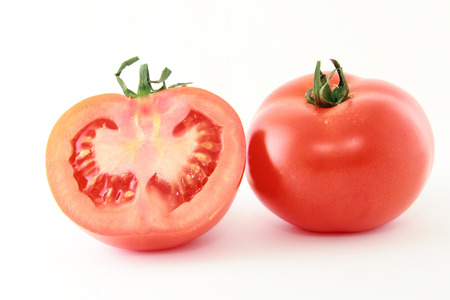 sectioned: sectioned fresh tomatoes on white background