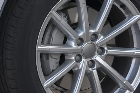 Wheel closeup with brake disc and caliper, alloy wheels Stock Photo