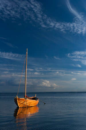 A classic wooden sailing boat in the port