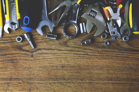 set of working tools on wood board background photo