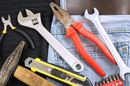 Tools in a blue jeans background and black background photo