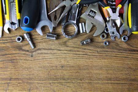 leveler: set of working tools on wood board background