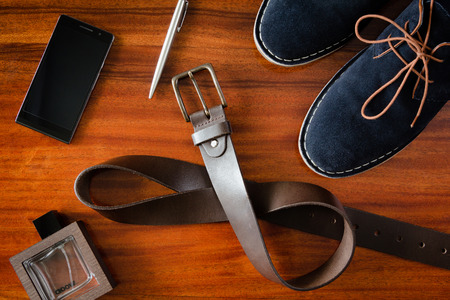 set of number mens accessories on wooden table